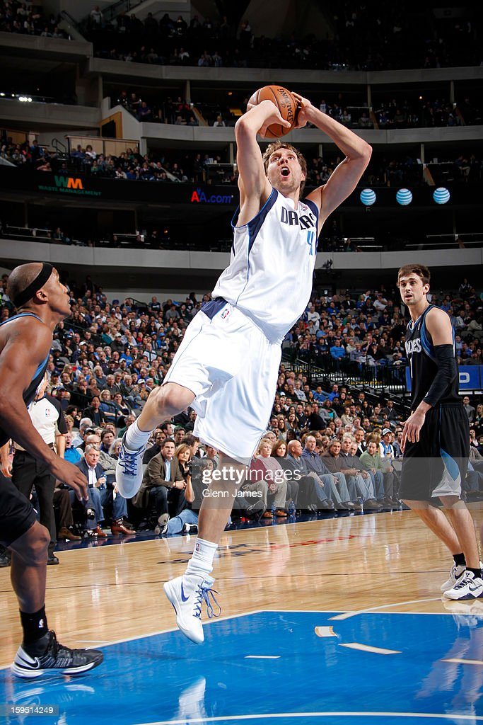 Dirk Nowitzki #41 of the Dallas Mavericks shoots in the lane against Dante Cunningham #33 of the Minnesota Timberwolves on January 14, 2013 at the American Airlines Center in Dallas, Texas.