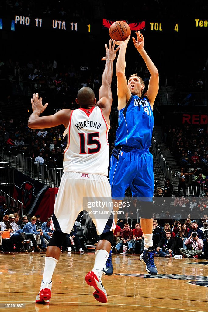 Dirk Nowitzki #41 of the Dallas Mavericks shoots over Al Horford #15 of the Atlanta Hawks on November 29, 2013 at Philips Arena in Atlanta, Georgia.