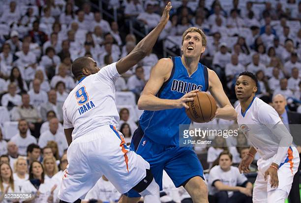 Dirk Nowitzki of the Dallas Mavericks shoots over Serge Ibaka of the Oklahoma City Thunder during the first half of Game Two of the Western...