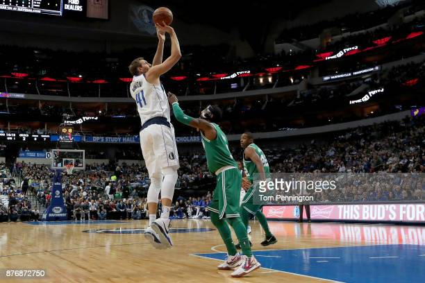 Dirk Nowitzki of the Dallas Mavericks shoots the ball against Kyrie Irving of the Boston Celtics in the first half at American Airlines Center on...