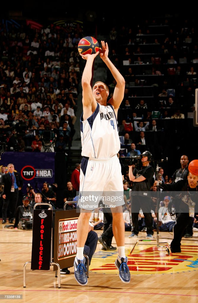 Dirk Nowitzki of the Dallas Mavericks shoots the money ball during the Footlocker ThreePoint Shootout at NBA AllStar Weekend on February 17 2007 at...