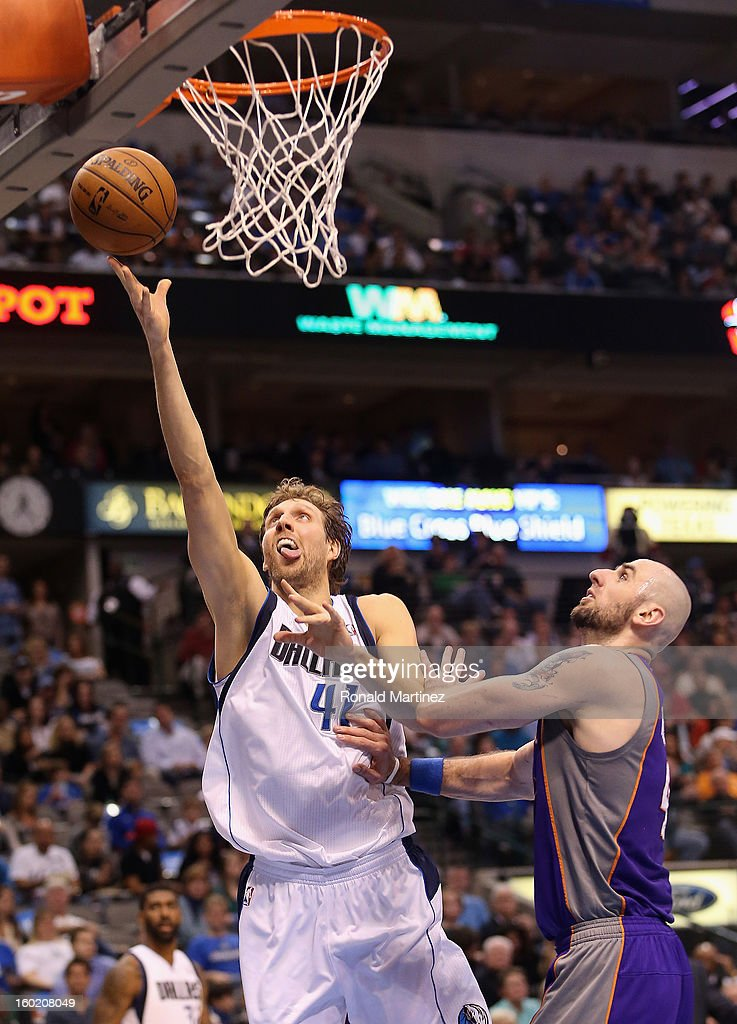 Dirk Nowitzki #41 of the Dallas Mavericks takes a shot against Marcin Gortat #4 of the Phoenix Suns at American Airlines Center on January 27, 2013 in Dallas, Texas.
