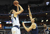 Dirk Nowitzki of the Dallas Mavericks takes a shot against Nick Collison of the Oklahoma City Thunder during game three of the Western Conference...