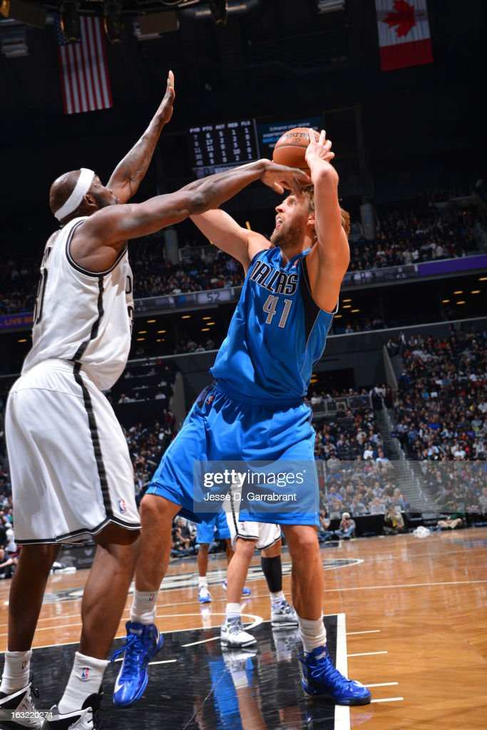 <a gi-track='captionPersonalityLinkClicked' href=/galleries/search?phrase=Dirk+Nowitzki&family=editorial&specificpeople=201490 ng-click='$event.stopPropagation()'>Dirk Nowitzki</a> #41 of the Dallas Mavericks takes a shot against the Brooklyn Nets on March 1, 2013 at the Barclays Center in Brooklyn, New York.