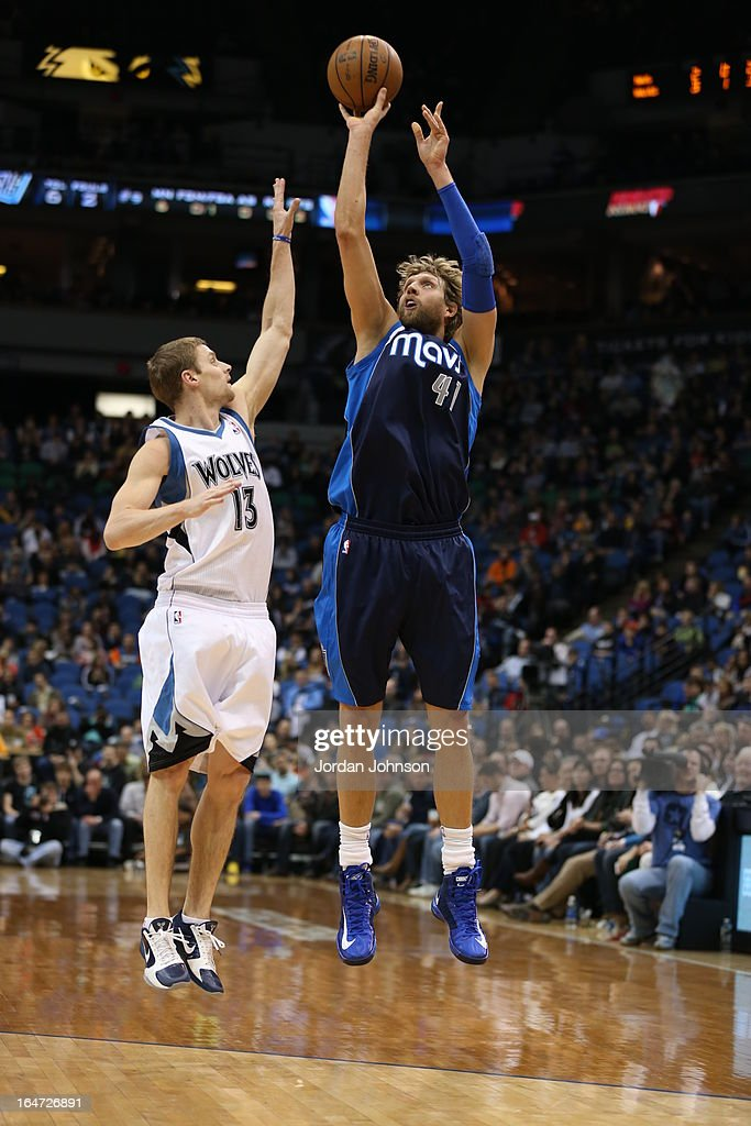 <a gi-track='captionPersonalityLinkClicked' href=/galleries/search?phrase=Dirk+Nowitzki&family=editorial&specificpeople=201490 ng-click='$event.stopPropagation()'>Dirk Nowitzki</a> #41 of the Dallas Mavericks takes a shot against the Minnesota Timberwolves on March 10, 2013 at Target Center in Minneapolis, Minnesota.