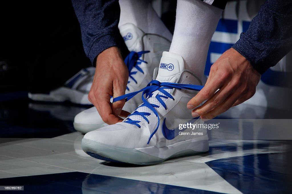 <a gi-track='captionPersonalityLinkClicked' href=/galleries/search?phrase=Dirk+Nowitzki&family=editorial&specificpeople=201490 ng-click='$event.stopPropagation()'>Dirk Nowitzki</a> #41 of the Dallas Mavericks ties his shoes before the game against the Chicago Bulls on March 30, 2013 at the American Airlines Center in Dallas, Texas.