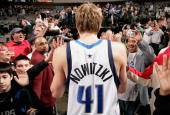 Dirk Nowitzki of the Dallas Mavericks walks off the court after the game against the New Orleans Hornets at the American Airlines Center on February...