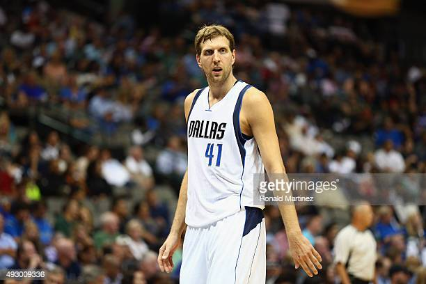Dirk Nowitzki of the Dallas Mavericks walks to the bench during a preseason game against the Atlanta Hawks at American Airlines Center on October 16...