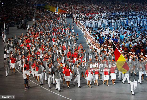 Dirk Nowitzki of the Germany Olympic men's basketball team carries his countries flag to lead out the delegation during the Opening Ceremony for the...