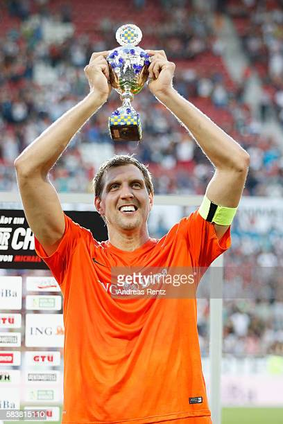 Dirk Nowitzki poses with the winner trophy during the 'Champions for charity' football match between Nowitzki All Stars and Nazionale Piloti in honor...