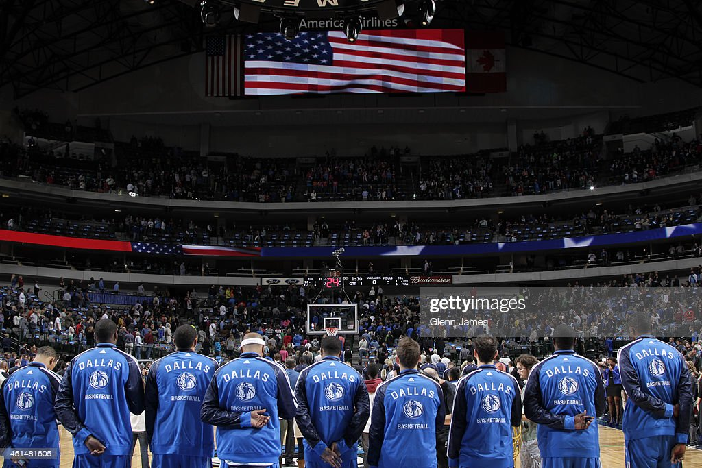 <a gi-track='captionPersonalityLinkClicked' href=/galleries/search?phrase=Dirk+Nowitzki&family=editorial&specificpeople=201490 ng-click='$event.stopPropagation()'>Dirk Nowitzki</a> #41and the Dallas Mavericks stand on the court before the game against the Washington Wizards on November 12, 2013 at the American Airlines Center in Dallas, Texas.