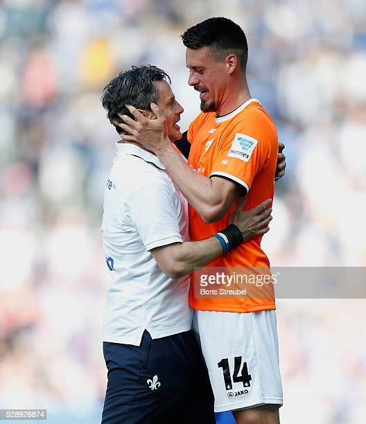 Dirk Schuster head coach of Darmstadt and team mate Sandro Wagner celebrate after winning the Bundesliga match between Hertha BSC and SV Darmstadt 98...