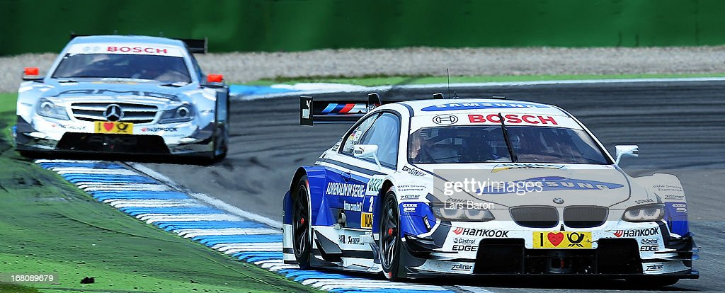 Dirk Werner of Germany and BMW Team Schnitzer drives infront of Christian Vietoris of Germany and Mercedes AMG during the first round of the DTM 2013 German Touring Car Championship at Hockenheimring on May 5, 2013 in Hockenheim, Germany.