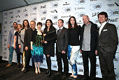 Dirk Wilutzky Mathilde Bonnefoy Laura Poitras Glenn Greenwald and the cast and crew of 'Citizenfour' pose in the press room with the award for best...