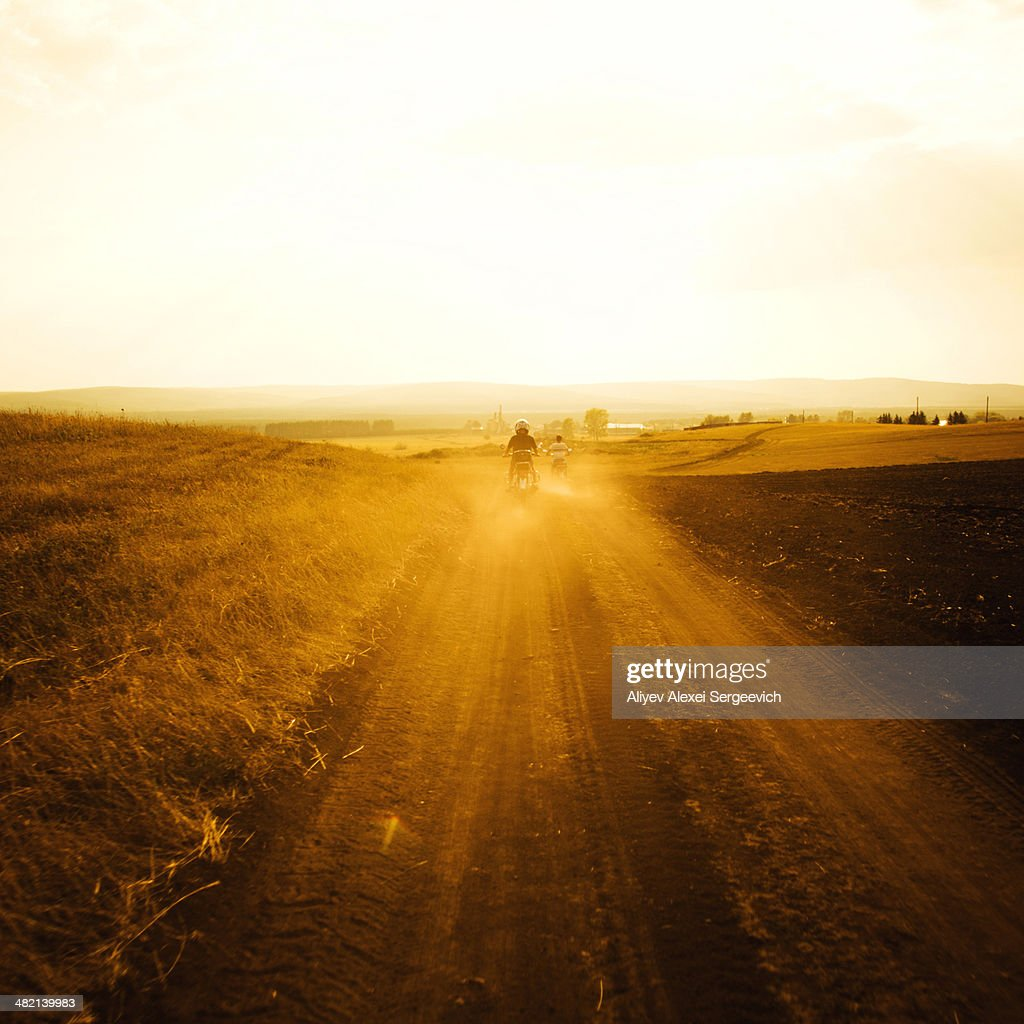 Dirt bikers driving on rural road