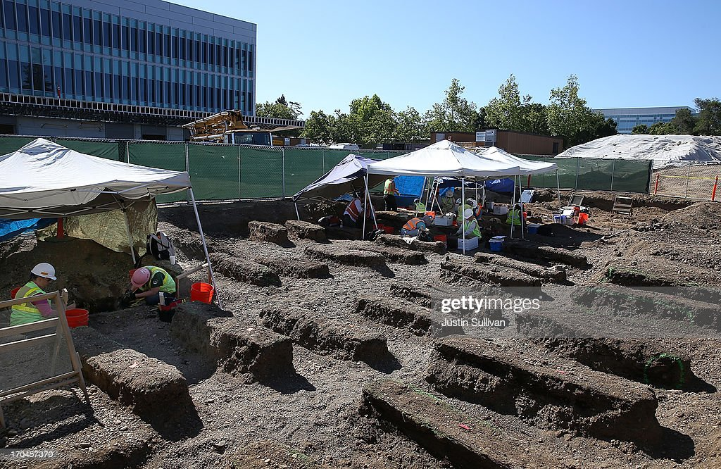 Dirt covered caskets are visible as workers sift through dirt while excavating an historic graveyard that was discovered during construction at Santa Clara Valley Medical Center on June 13, 2013 in San Jose, California. Osteologists and archeologists have excavated the remains of 631 people from a construction site at Santa Clara Valley Medical Center along with a number of artifacts that date back to the late 1800s. The excavated graves are bellieved to have been from between the late 1800s and the 1920s. The potter's field, a graveyard reserved for burial of persons who were indigent, unknown or unclaimed, was uncovered by construction crews in February 2012 while doing grading work for the constructin of a new hospital services Building.