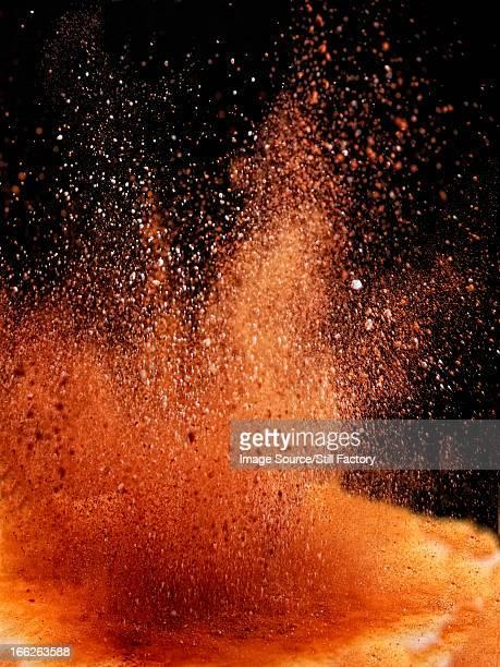Dirt exploding on ground