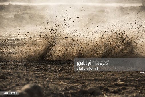 dirt fly after motocross roaring by : Stock Photo