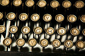 Close up of antique typewriter keys that are dirty and dusty.