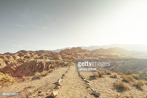 dirt path leading to rocky landscape
