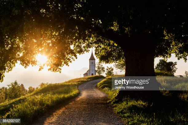 Dirt road leading to remote hilltop church
