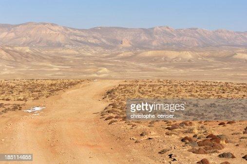 Dirt road through desert, Afghanistan