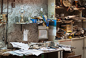 dirty and abandoned office with books and papers