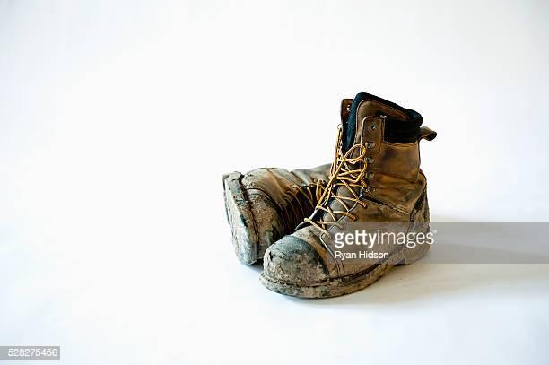 Dirty and broken in construction work boots; edmonton alberta canada