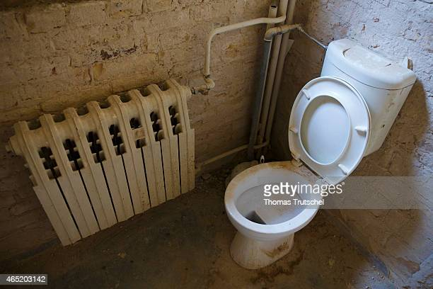 Dirty and dusty toilet in an old house on February 28 2015 in Berlin Germany