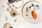 Dirty and empty dishes after party breakfast  Real life concept at home with woman's accessories.