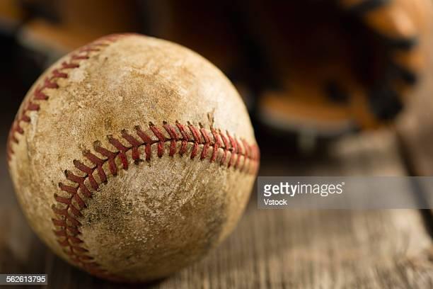Dirty baseball on wood