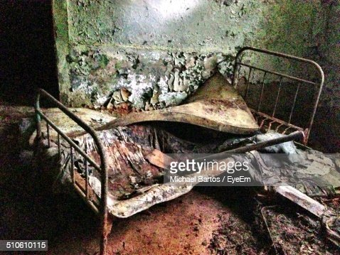 Dirty Bed In An Abandoned House Stock