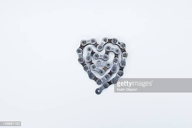 Dirty bicycle chain shaped as a heart