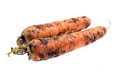 dirty Carrots isolated on white background