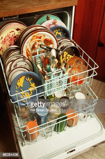 Dirty Dishes In Dishwasher Stock Photo | Getty Images