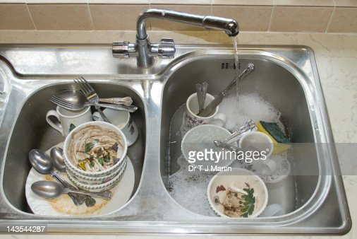 Kitchen Sink With Dishes dirty dishes in kitchen sink stock photo | getty images