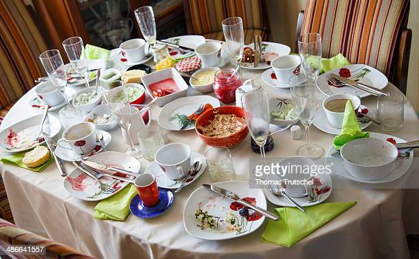 Dirty dishes left behind after brunch on April 20 in Buecheloh Germany
