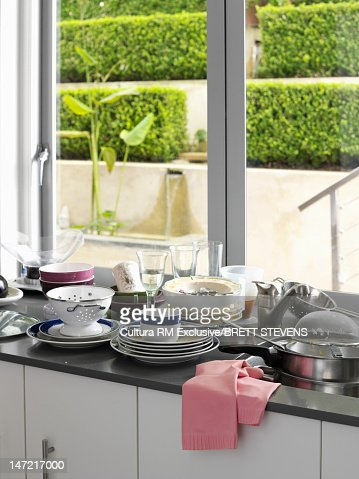 Dirty dishes piled in kitchen