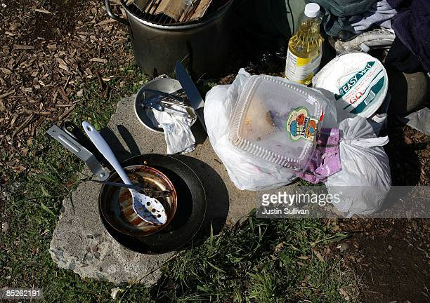 Dirty dishes sit on a rock at a homeless tent city on March 5 2009 in Sacramento California Sacramento's tent city is seeing an increase in...