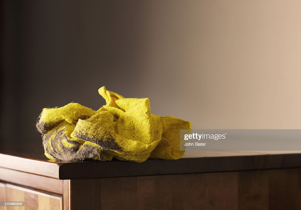 Dirty duster on cabinet : Stock Photo