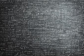 dirty grunge chalkboard full of mathematical problems and formula
