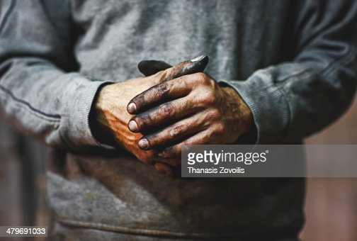 Dirty hands of a worker
