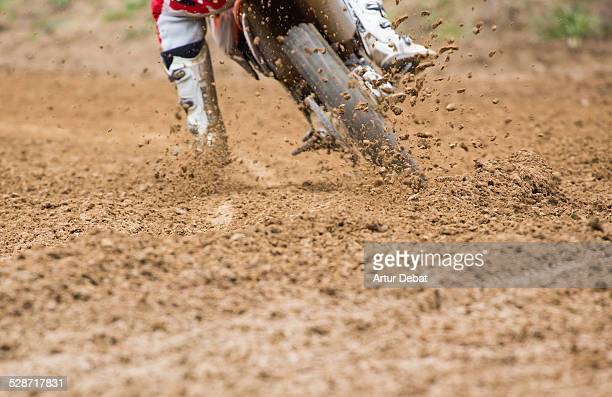 Dirty motocross with mud splatter in offroad track