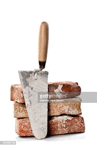 Dirty Red Brick and Trowel