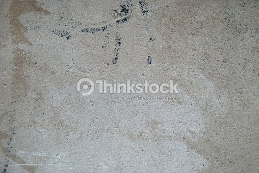 Dirty Urban Concrete Wall With Marks And Black Spray Paint