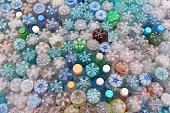 Dirty used colored plastic bottle pile.