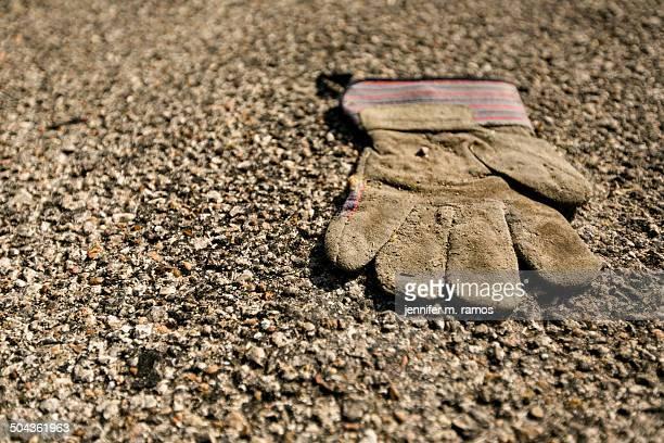 Dirty Work Glove on pavement