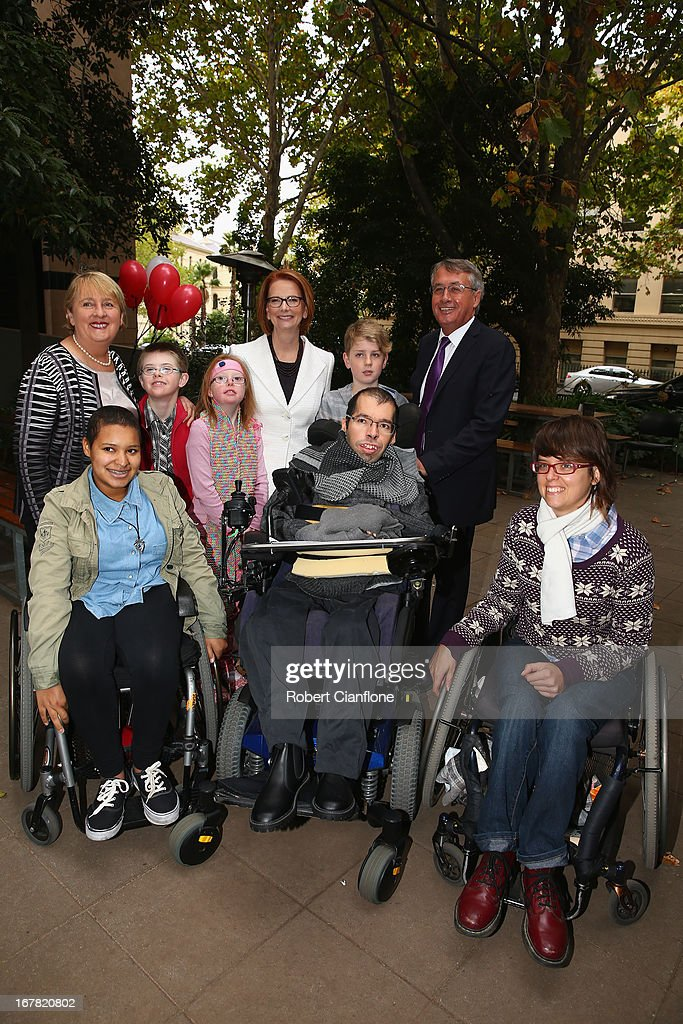 Disability Reform Minister Jenny Macklin (L), Australian Prime Minister <a gi-track='captionPersonalityLinkClicked' href=/galleries/search?phrase=Julia+Gillard&family=editorial&specificpeople=787281 ng-click='$event.stopPropagation()'>Julia Gillard</a> (C) and Treasurer <a gi-track='captionPersonalityLinkClicked' href=/galleries/search?phrase=Wayne+Swan&family=editorial&specificpeople=4582809 ng-click='$event.stopPropagation()'>Wayne Swan</a> (2nd R) meet members of the disabled community after a press conference at the Commonwealth Parliamentary Office on May 1, 2013 in Melbourne, Australia. Gillard has announced that the Federal Government will increase the Medicare levy on income tax from 1.5 to two percent to help fund the National Disability Insurance Scheme (NDIS). The levy will begin on July 1, 2014 and is expected to raise around $3.2 billion annually towards the NDIS which is expected to cost $8 billion per year.