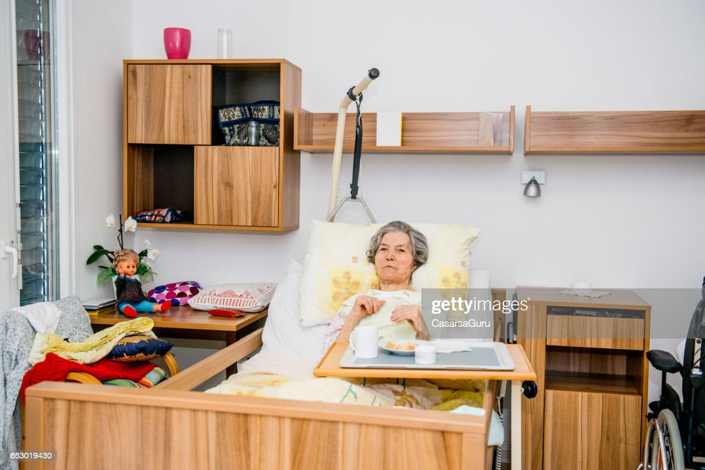 Disable Senior Woman Having Breakfast In Her Bed At The Retirement Home : Photo