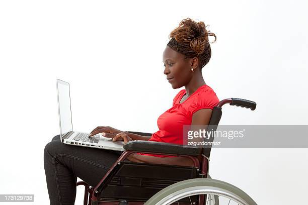 Disabled African woman using laptop